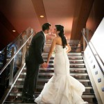 Real Bride Jordan and Husband Anthony Kiss on Steps