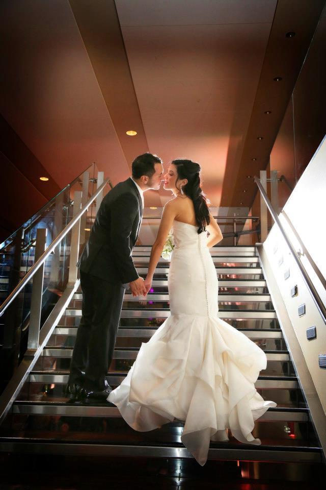 Real Bride Jordan and Husband Anthony Kiss on Steps